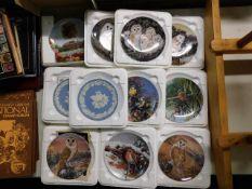 A quantity of decorative collectors plates