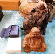 A carved wooden Buddha, one other Buddha & a small