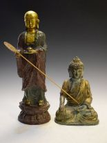 Lot 6 - South East Asian gilt metal cast figure of a seated Buddha, with crossed legs, open left palm and