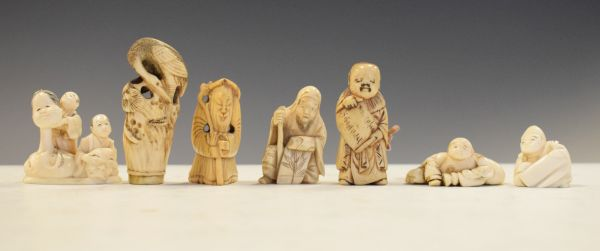 Lot 284 - Group of seven Japanese late Meiji period carved ivory netsuke to include; a figure group holding