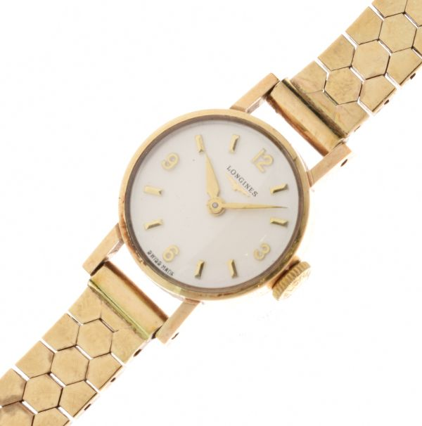 Lot 28 - Longines - Lady's 9ct gold mechanical wristwatch on a 9ct gold bracelet, 16g gross, cased -