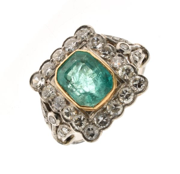 Lot 49 - Emerald and diamond cluster ring, unmarked, the step cut emerald approximately 8mm x 6.2mm x 4.3mm