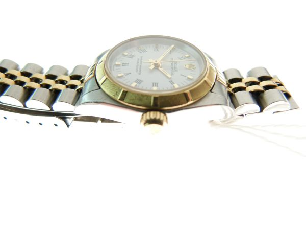 Lot 27 - Rolex - Lady's yellow metal and steel Oyster Perpetual Chronometer wristwatch, ref:76233, serial