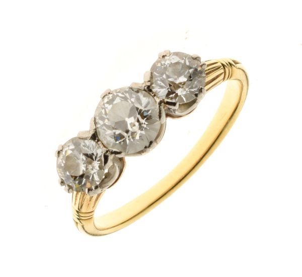 Lot 39 - Three stone diamond ring, unmarked yellow mount, the graduated old brilliant cuts totalling