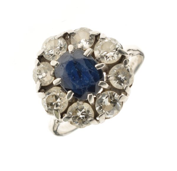 Lot 60 - Sapphire and diamond nine stone cluster ring, the white mount with Continental marks, the oval cut