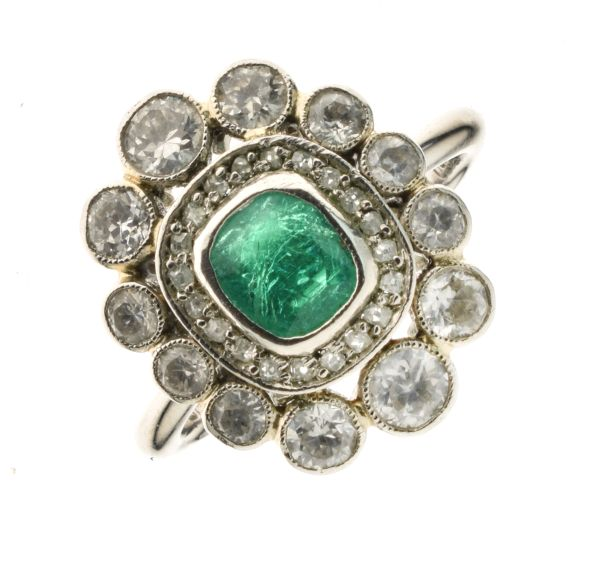 Lot 51 - Emerald and diamond platinum cluster ring, the rectangular mixed cut emerald approximately 5mm x 4.