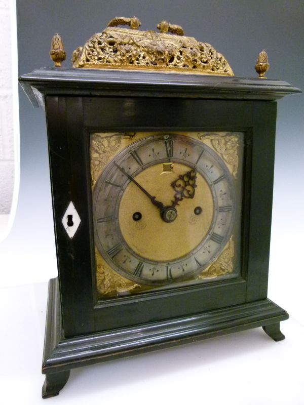 Lot 15 - 17th Century and later ebonised bracket or table clock, the unsigned 6-inch square brass dial with