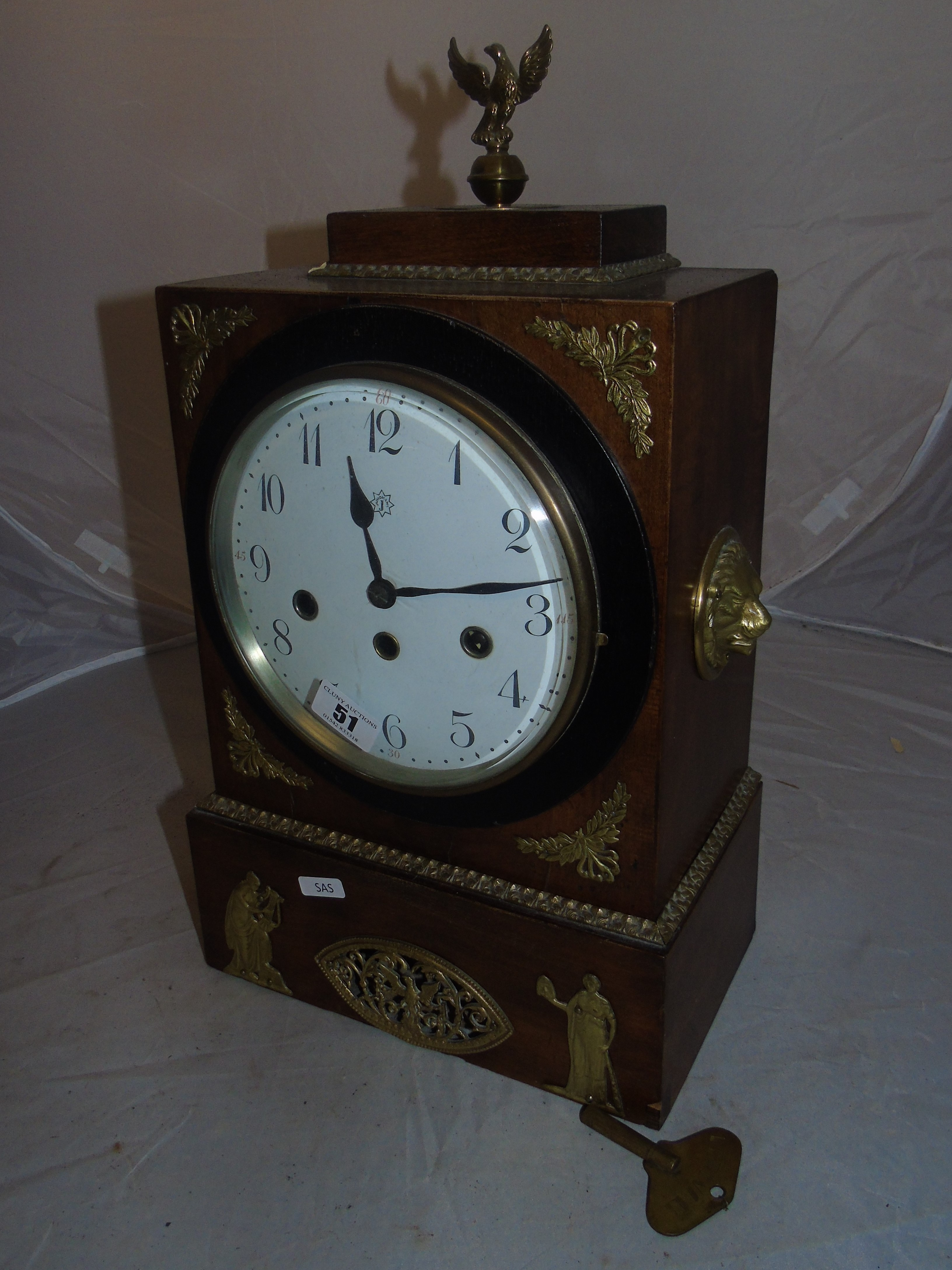 Lot 51 - JUNGHANS WALNUT MANTLE CLOCK. A CONVEX DIAL WITH BRASS MOUNTS .HANDLES & FINIAL 4 HAMMER WESTMINSTER