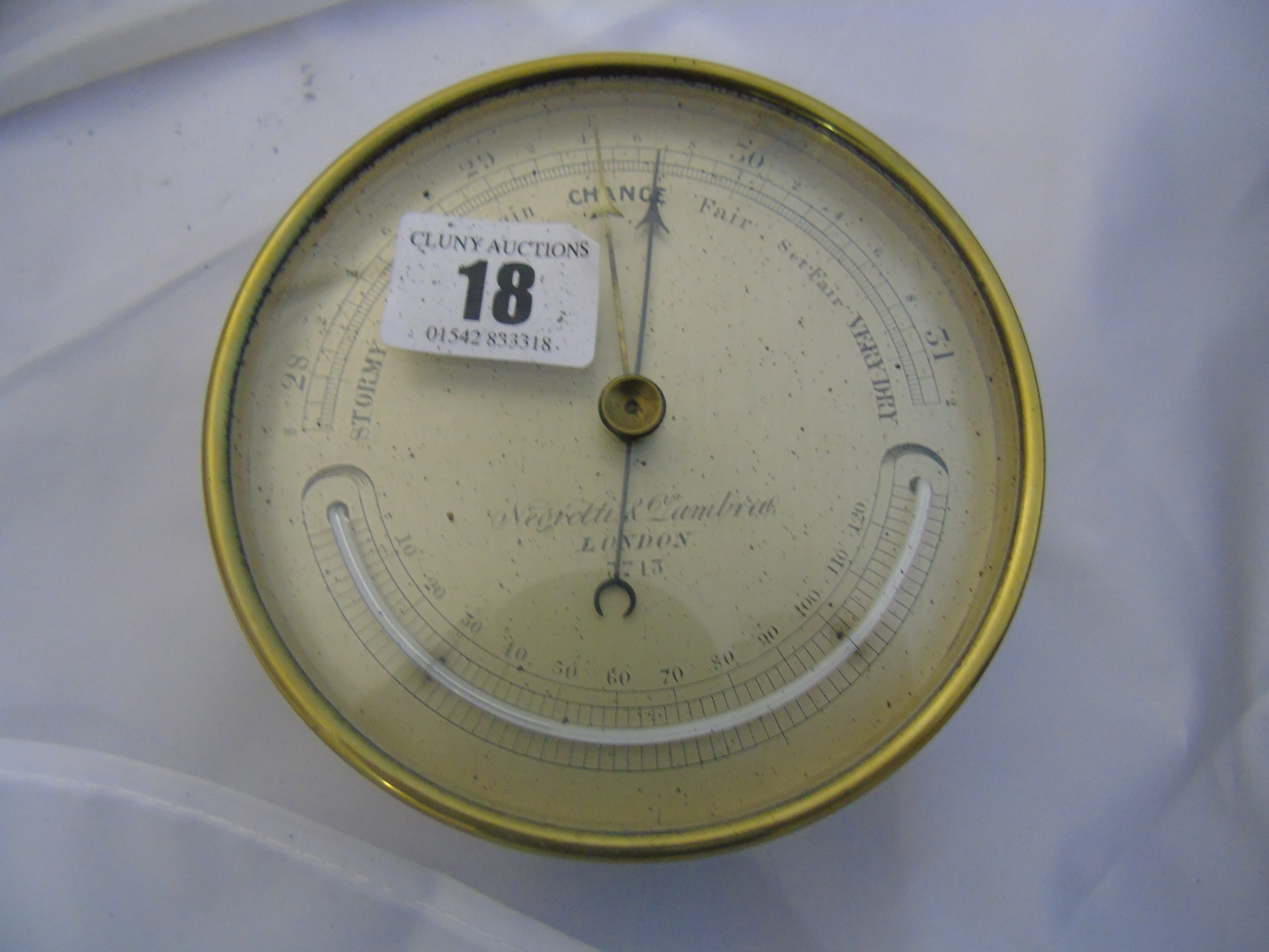 Lot 18 - BRASS CASED ANEROID BAROMETER MADE BY NEGRETTI & ZAMBRA LONDON IN A GERMAN MILITARY BOX