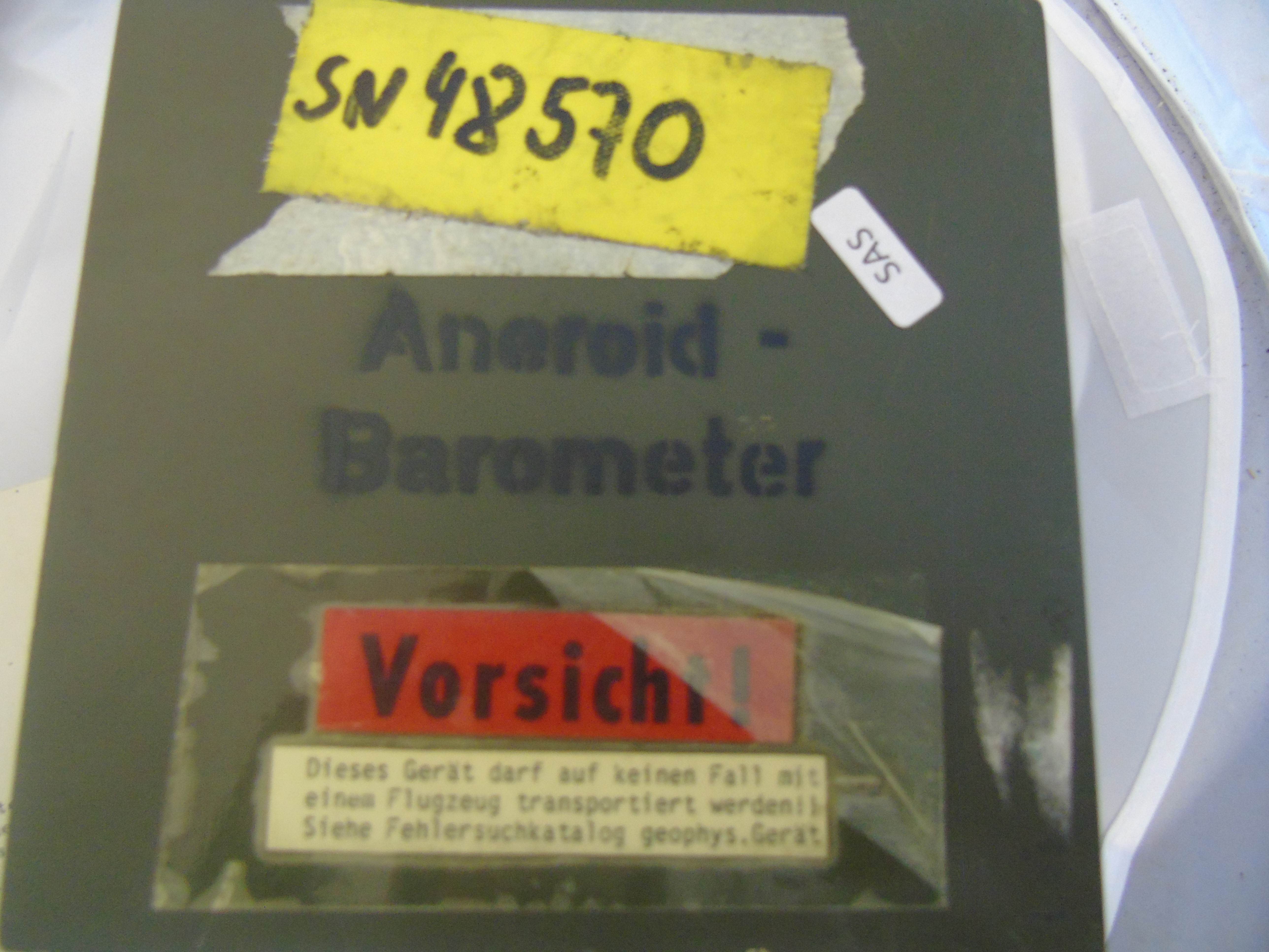 Lot 18 - BRASS CASED ANEROID BAROMETER MADE BY NEGRETTI & ZAMBRA LONDON IN A GERMAN MILITARY BOX EST [£60-£