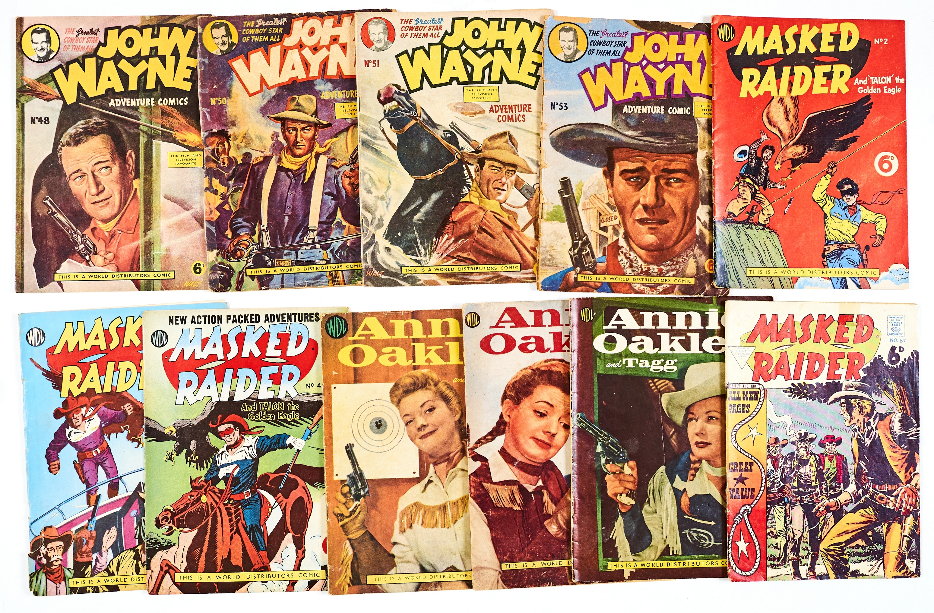 Lot 56 - John Wayne Adventure Comics (1950s WDL) 48, 50, 51, 53. With Masked Raider 2, 3, 4, 67 and Annie