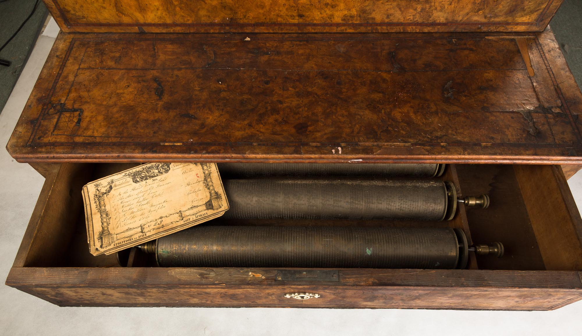 """Lot 214 - French Interchangeable Cylinder Music Box. French, 19th century. (6) 16"""" cylinders. One broken"""