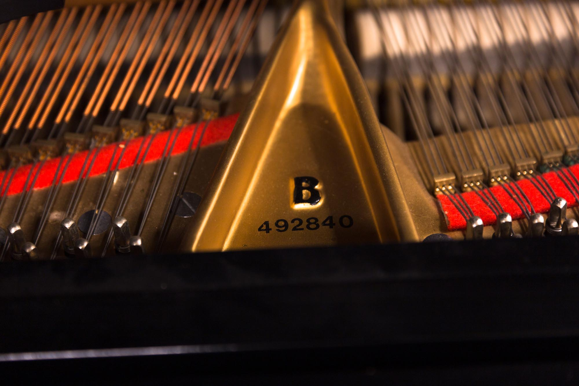 "Lot 216 - Steinway Ebony Model B. Ebony veneer. Serial No: 492840 L 83"" W 58"". Online bidding available:"
