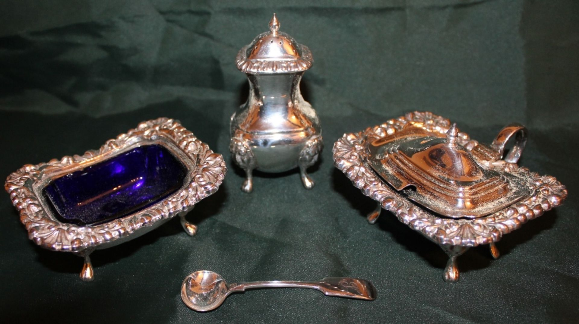 Lot 357 - DECORATIVE SILVER TABLE CRUET SET WITH LION MASK AND PAD FEET,