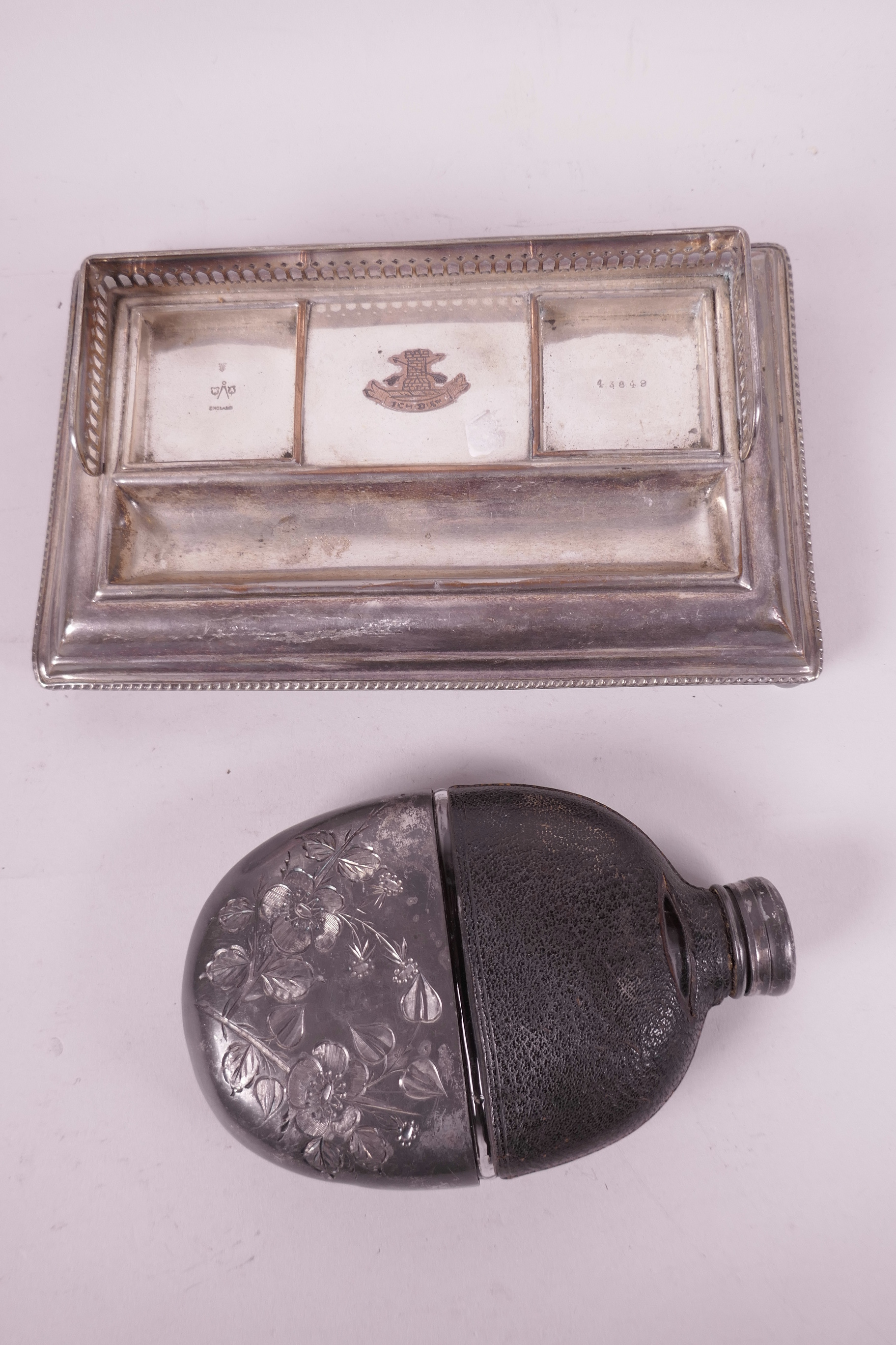 """Lot 647 - A silver plated desk inkstand, 8½"""" x 5"""", together with a leather cased glass hip flask with silver"""