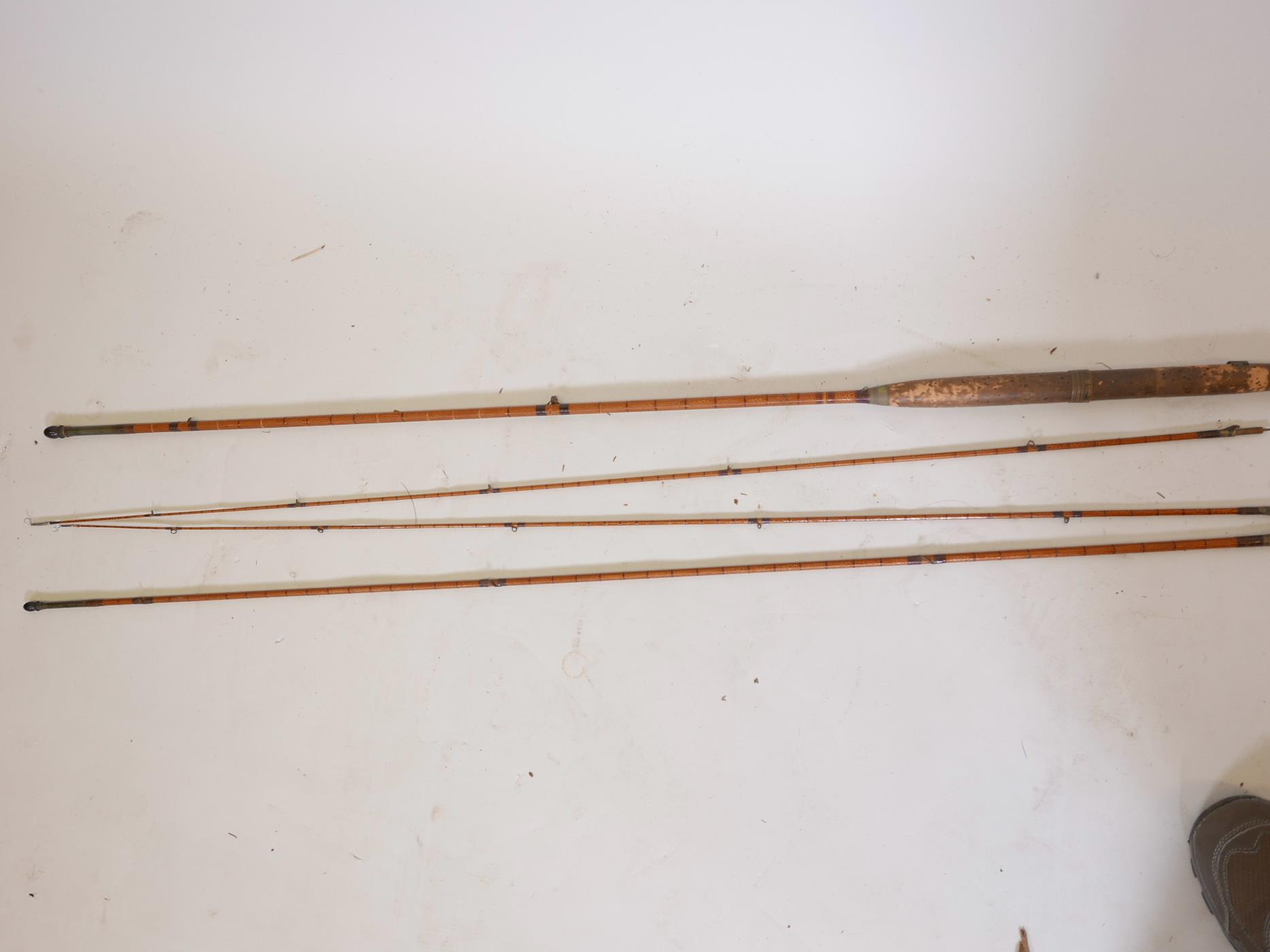 Lot 76 - A Hardy Bros split cane three section gold medal fly fishing rod with spare top section, original