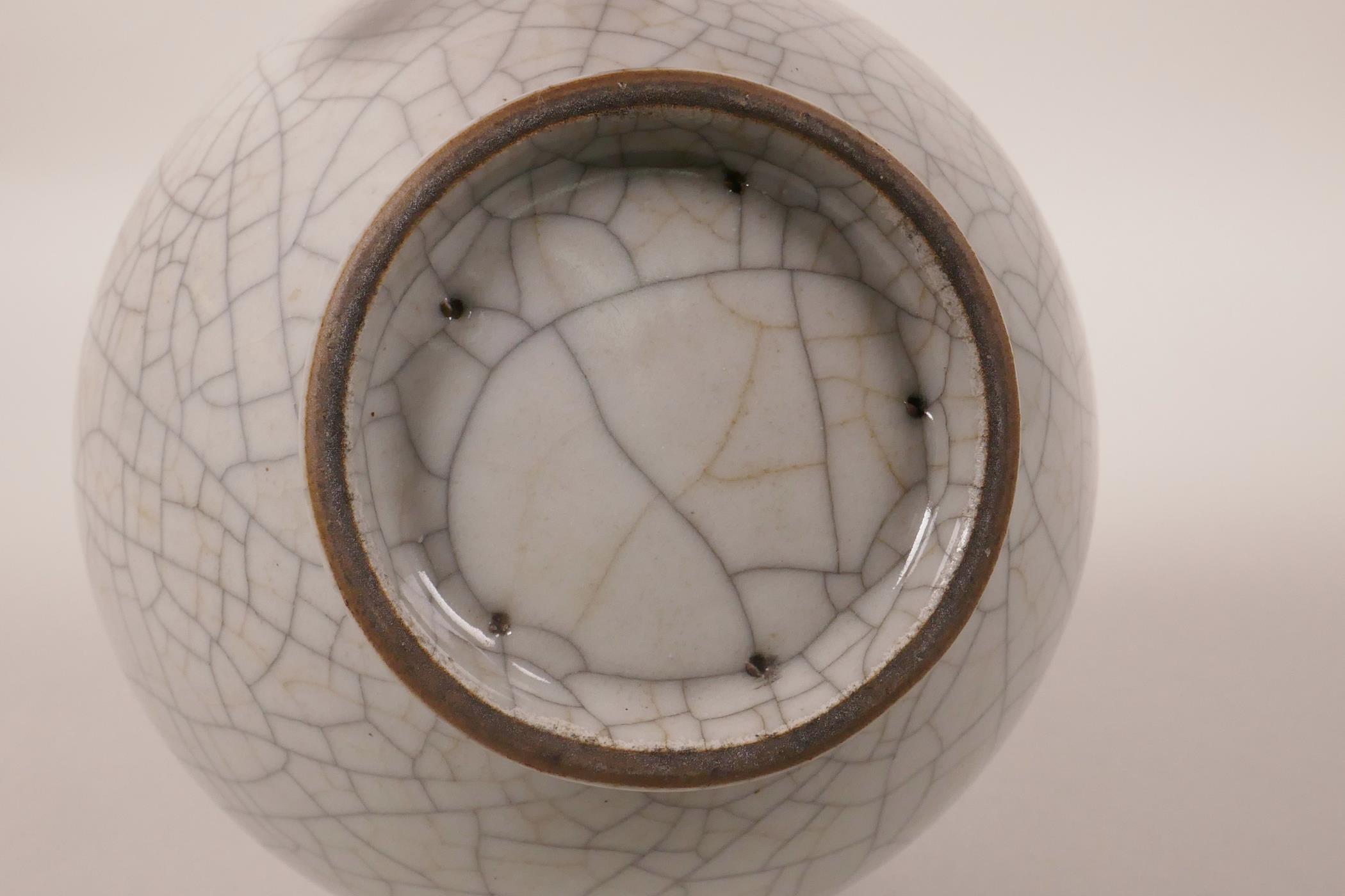 "Lot 78 - A Chinese grey crackle glazed two handled bottle vase, 9"" high"