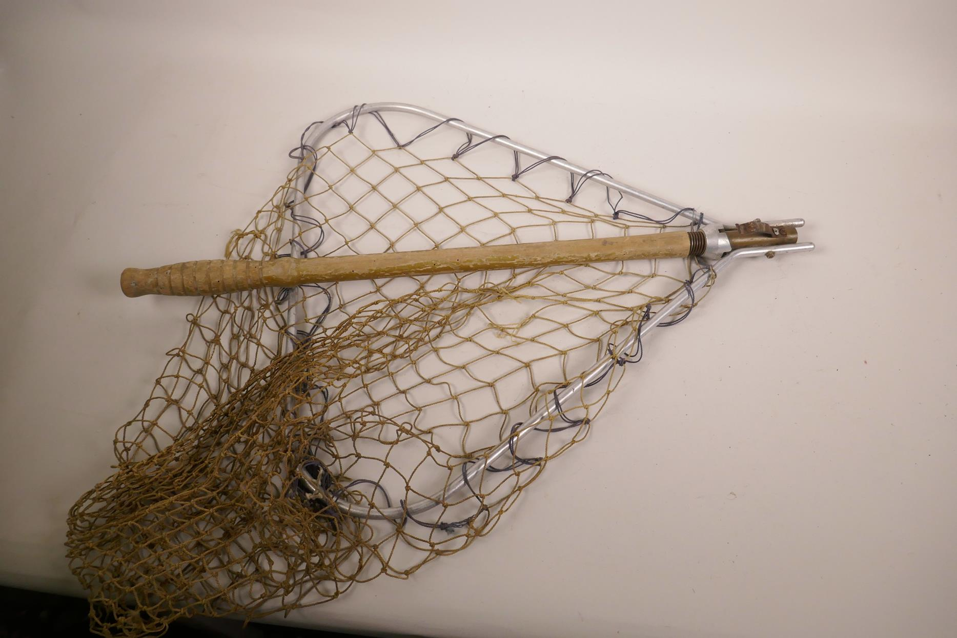 "Lot 64 - A vintage wooden handled folding landing net with aluminium frame, 37"" long"