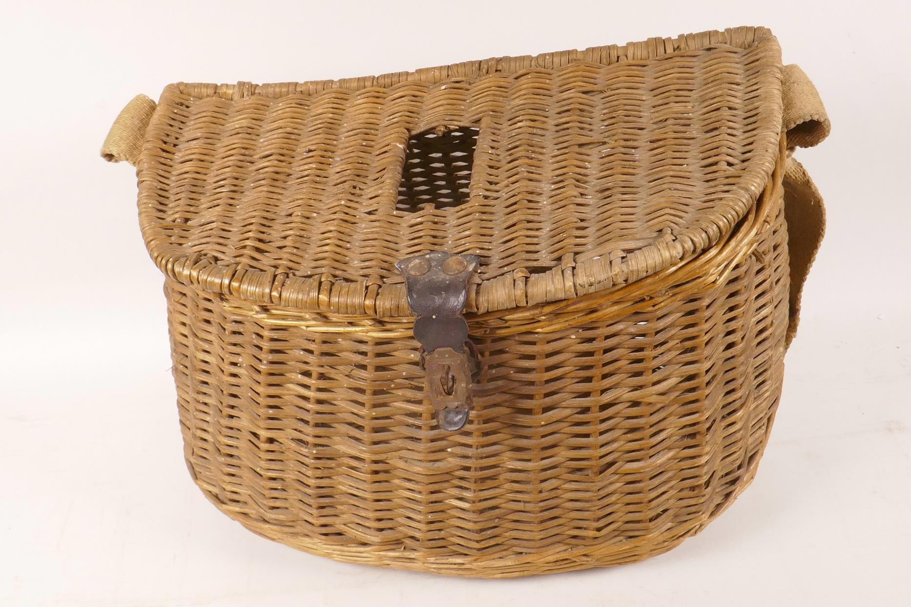 "Lot 34 - A vintage woven fishing basket/creel, 12"" wide"