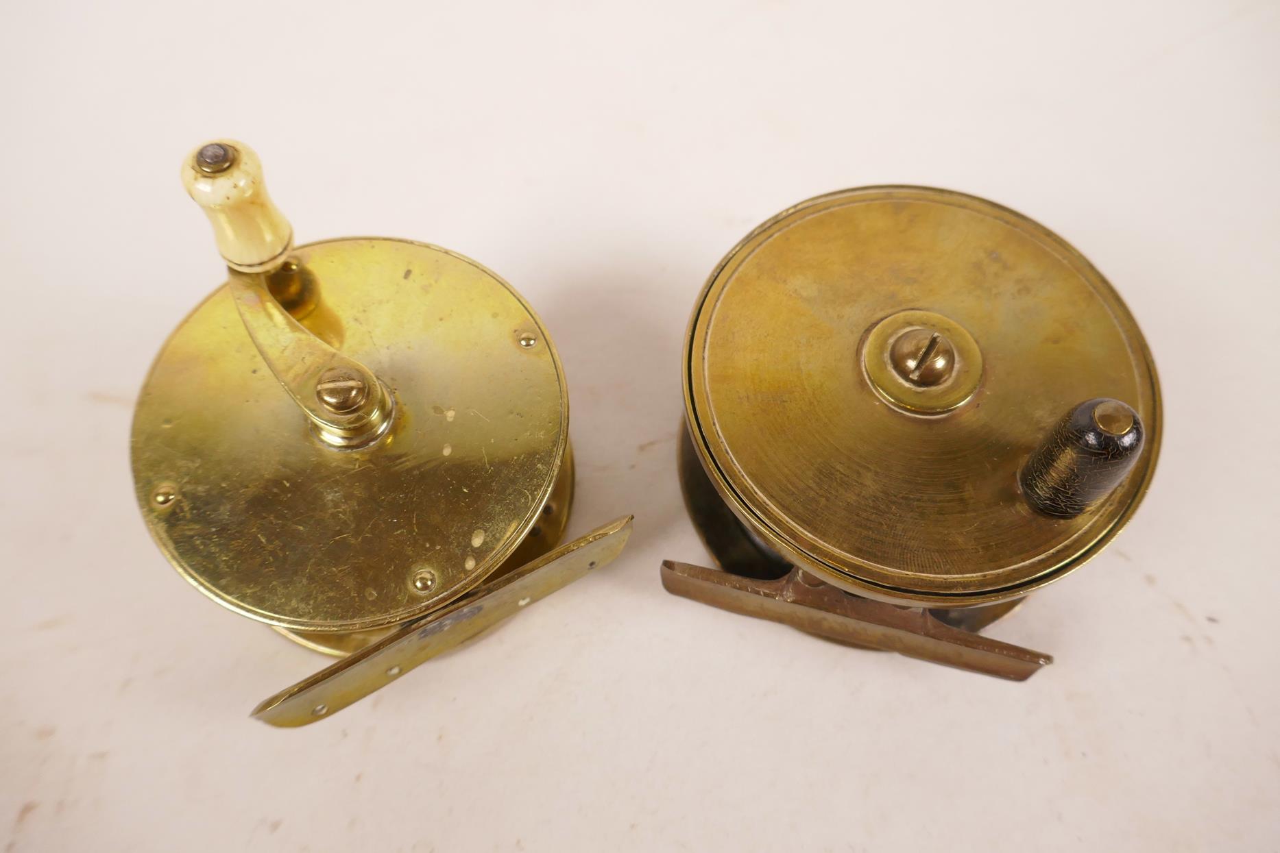 "Lot 72 - Two early brass trout fishing reels, 2¾"" x 2¼"" diameter"
