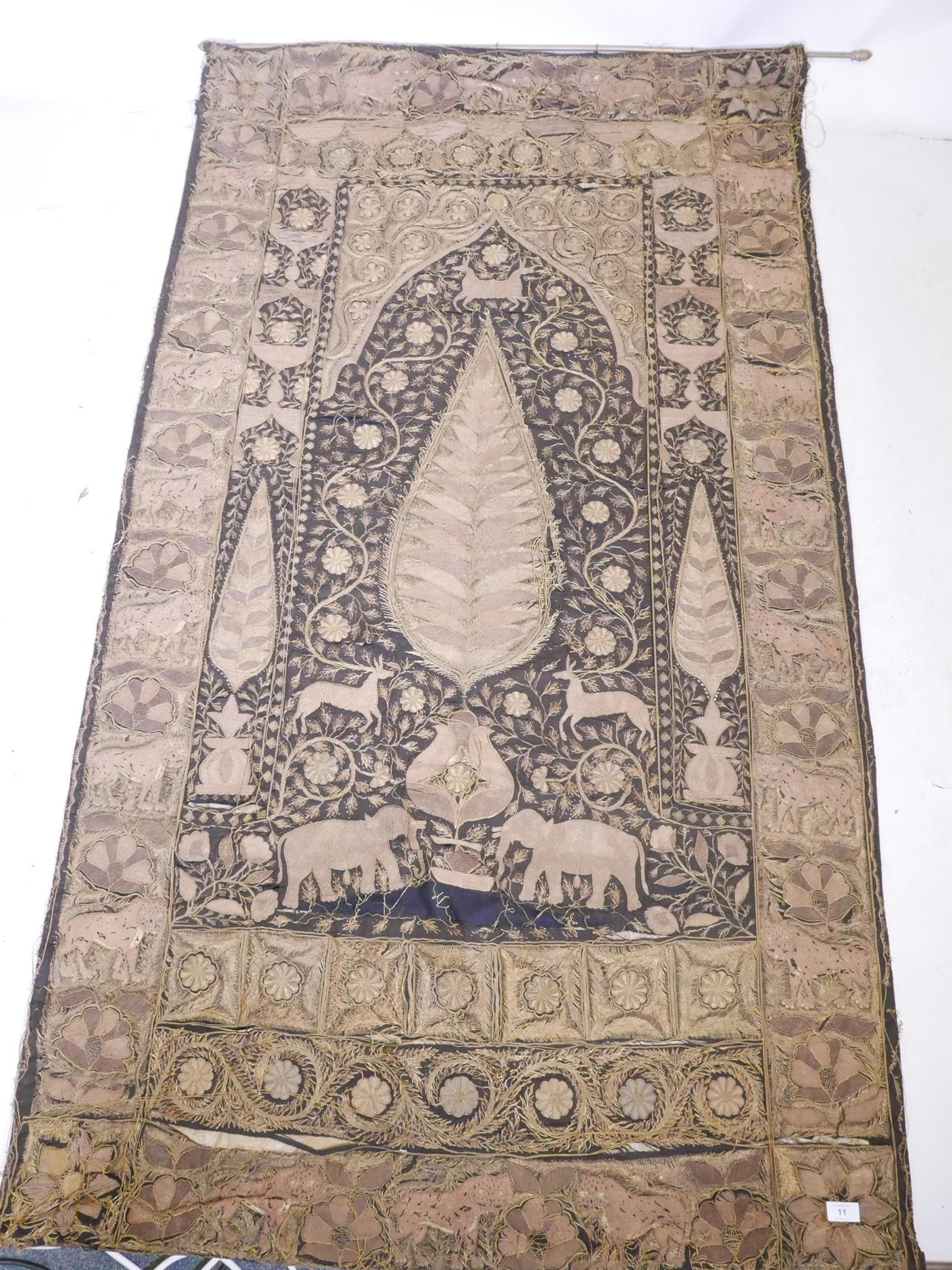 Lot 11 - An Indian gilt thread embroidered wall hanging with rosettes, elephants and tiger decoration, A/F
