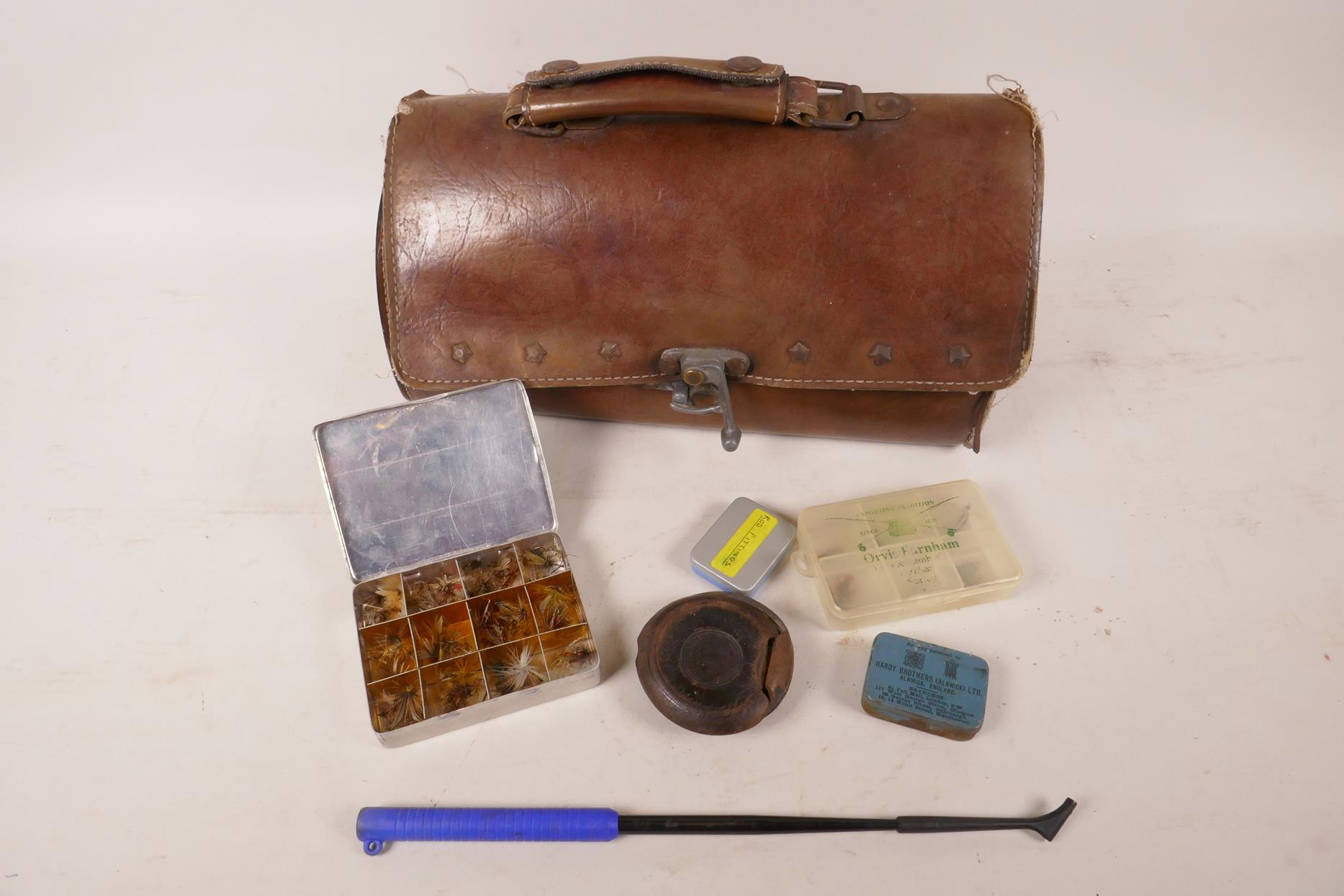 """Lot 39 - A leather bag containing various vintage fishing equipment including fly box and flies, 11"""" long"""