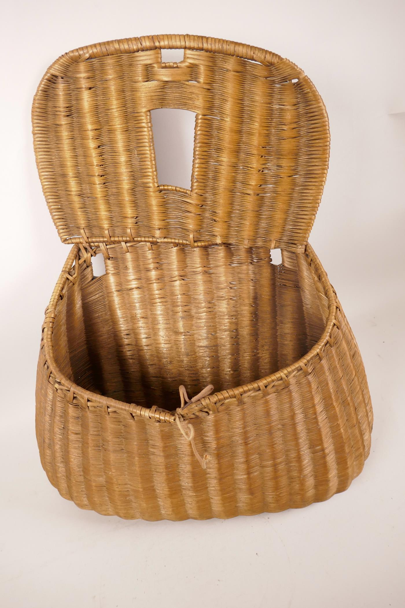 """Lot 47 - A vintage woven fishing basket/creel 13"""" wide, A/F"""