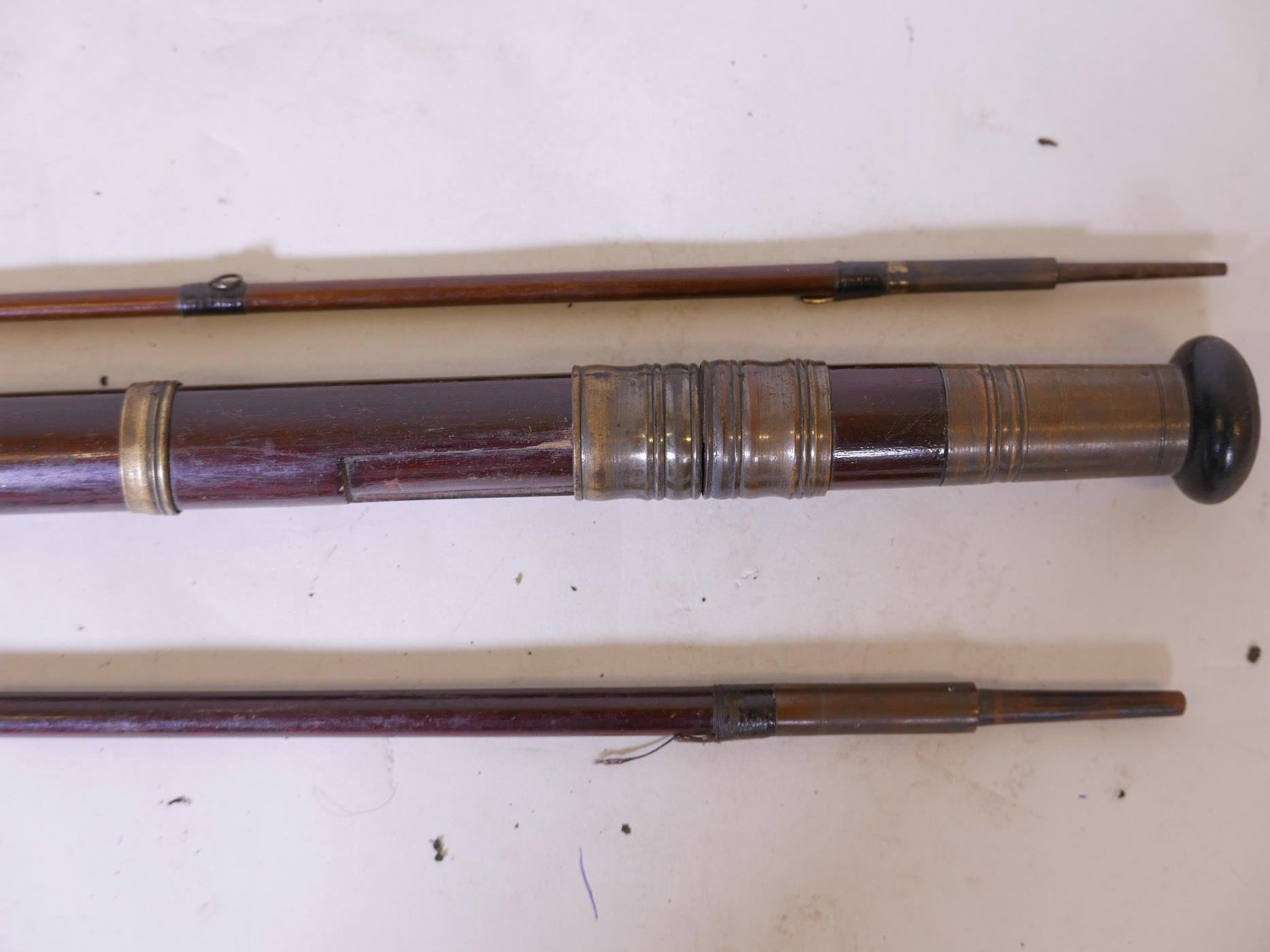 Lot 26 - A vintage hardwood three section fly fishing rod, 12' long