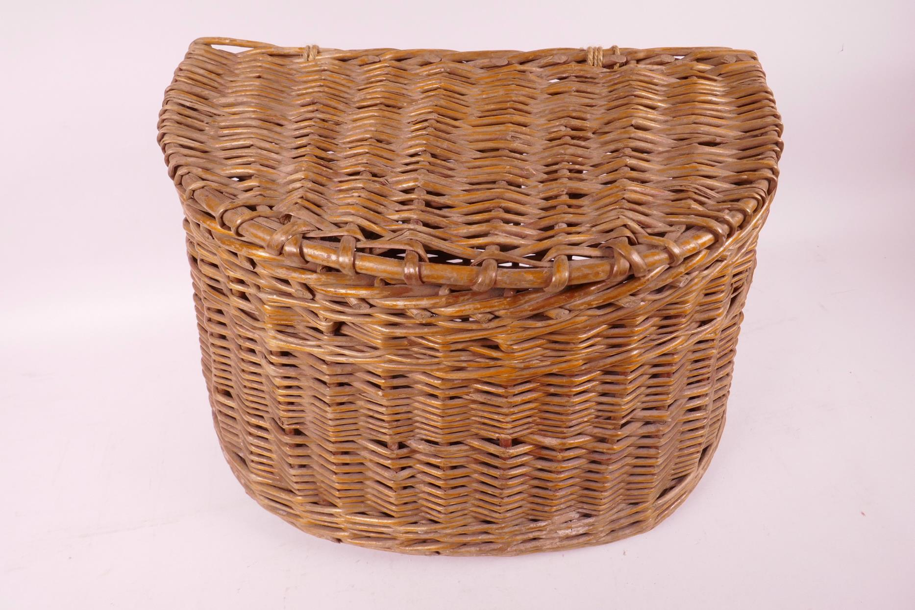 "Lot 24 - A vintage woven fishing basket/creel, 13"" wide"