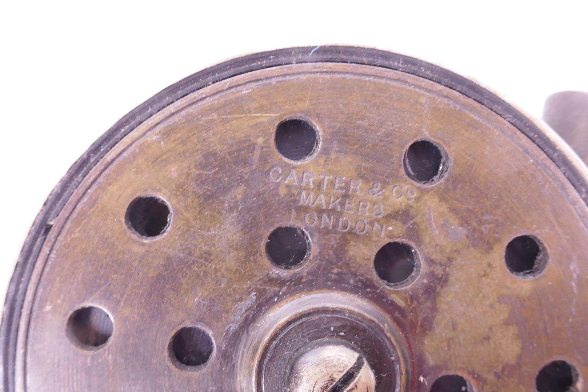 "Lot 55 - A vintage Carter and Co. aluminium and brass 2½"" fishing reel"