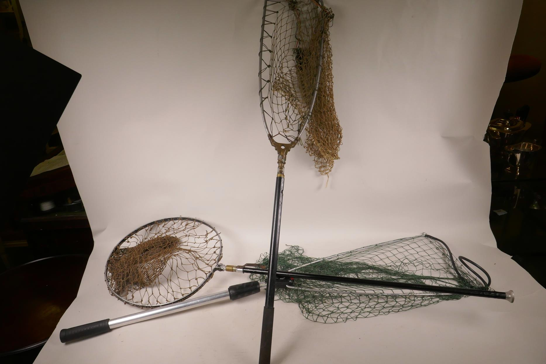 Lot 16 - Three various folding landing nets