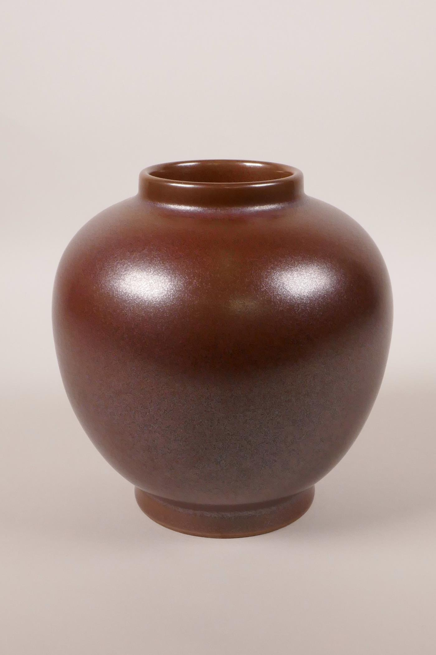 """Lot 18 - A Chinese iridescent copper glazed porcelain jar, 6 character mark to base, 6"""" high"""