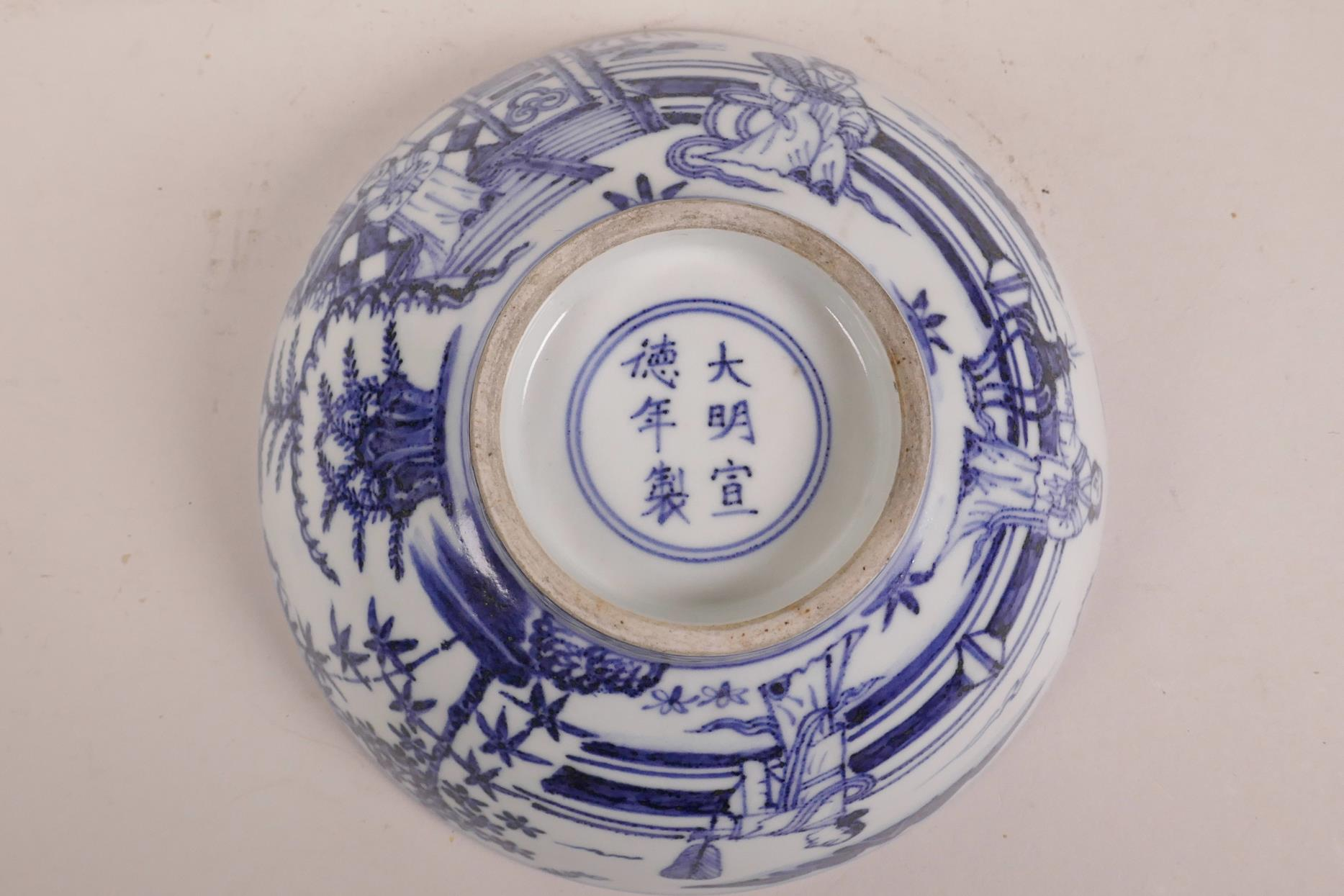 Lot 75 - A Chinese blue and white porcelain bowl decorated with figures in a garden, 6 character mark to