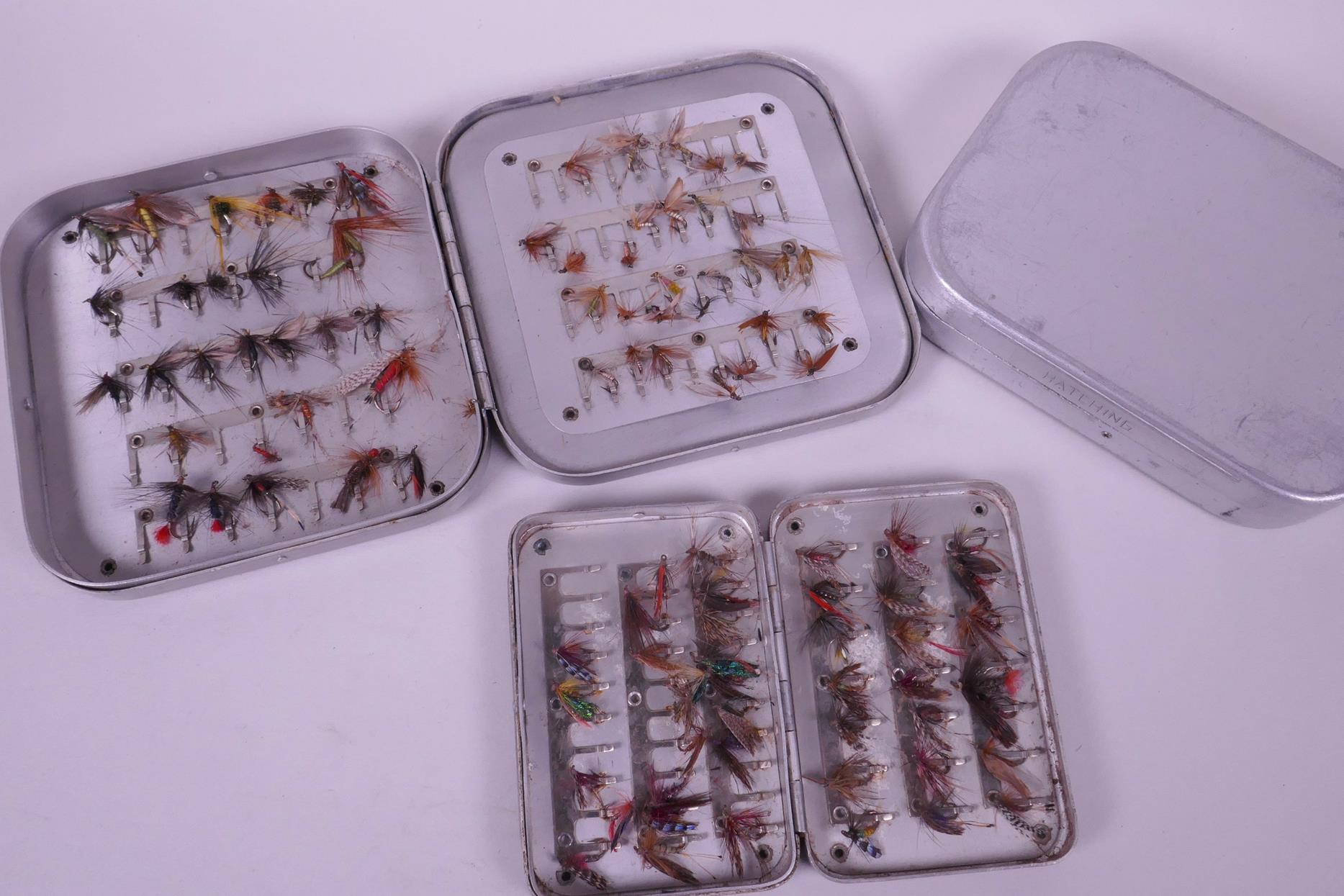 Lot 45 - Two vintage aluminium fishing fly boxes with flies, together with a third empty box