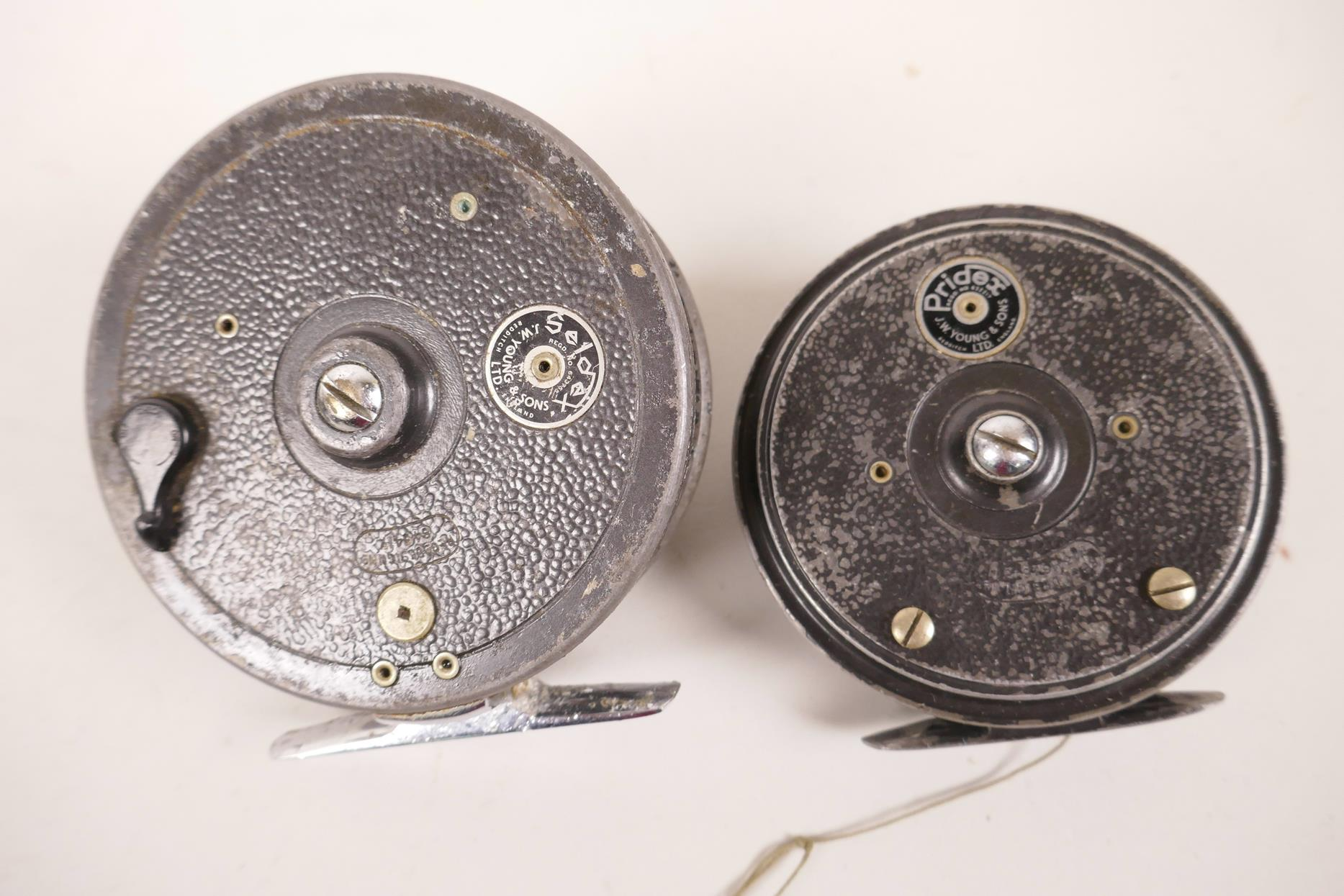 """Lot 12 - Two vintage J.W. Young & Sons salmon fishing reels, a Seddex, 4"""" diameter and a Pridex"""
