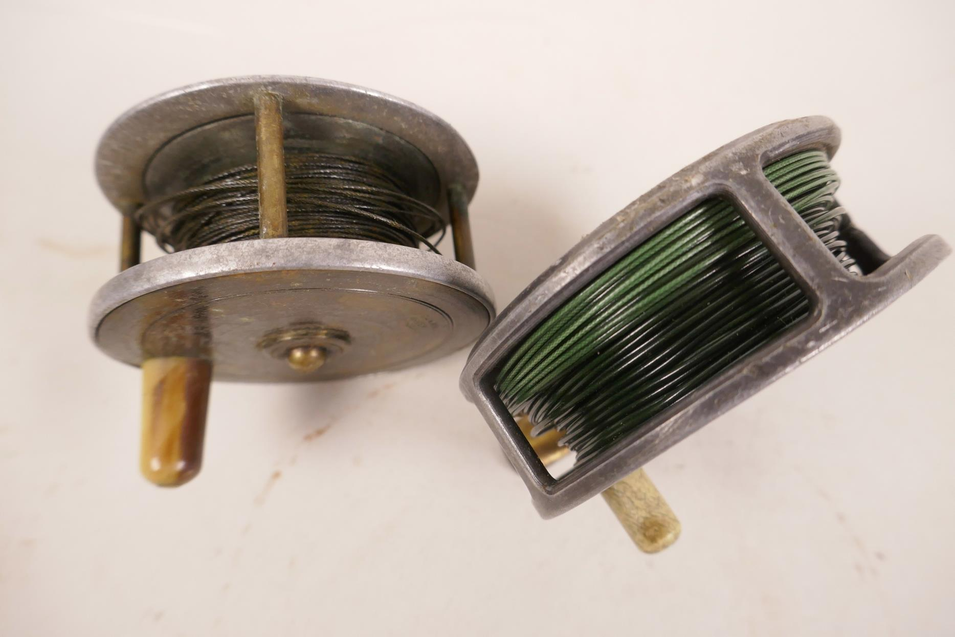 """Lot 82 - A vintage 3"""" trout fishing reel by Arthur Allen of Glasgow, together with a similar brass and"""