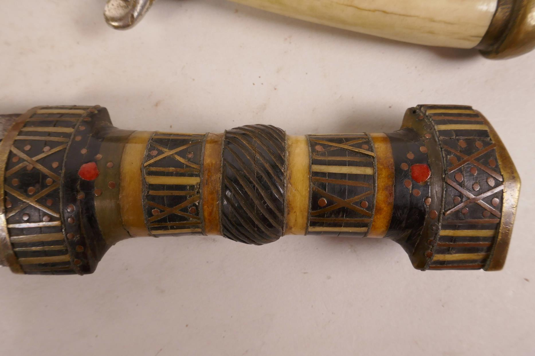 "Lot 44 - An Oriental dagger with curved blade, bone handle and brass mounts, 12"" long, another similar, 13"""
