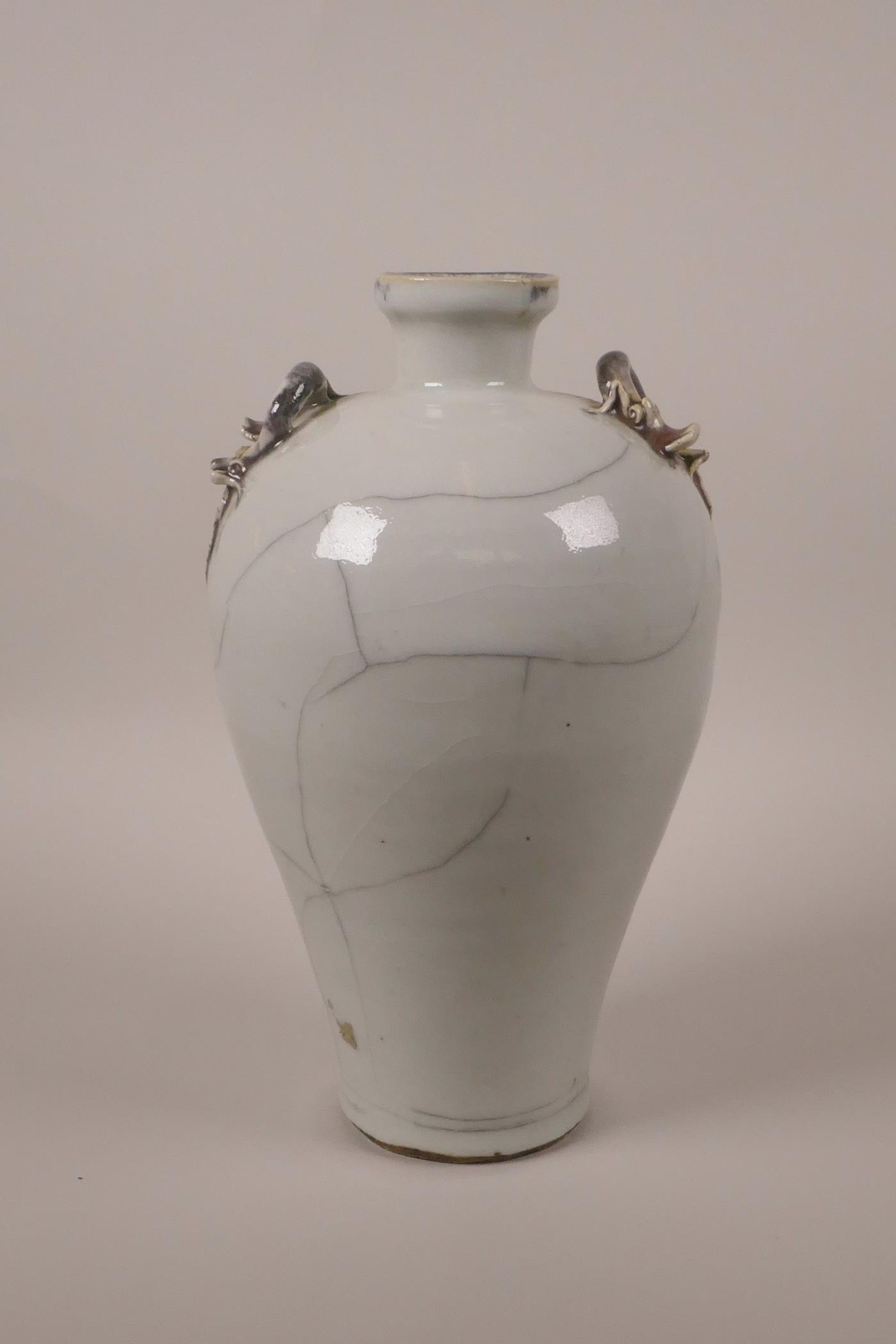 """Lot 28 - A Chinese crackle glazed pottery vase with two dragon handles, 9½"""" high"""