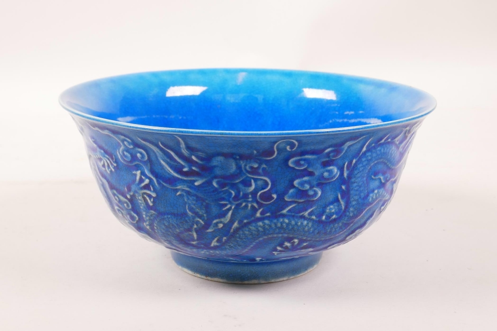 Lot 3 - A Chinese blue glazed porcelain rice bowl with underglaze dragon decoration, 6 character mark to