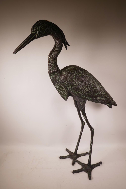 """Lot 1 - A bronzed metal garden figure of a heron, 33"""" high"""