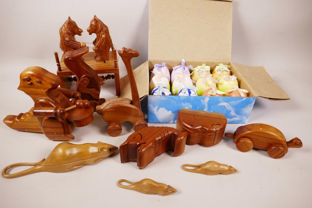 Lot 7 - A quantity of animated wooden toys, two puzzle trinket boxes and a box of painted eggs with surprise