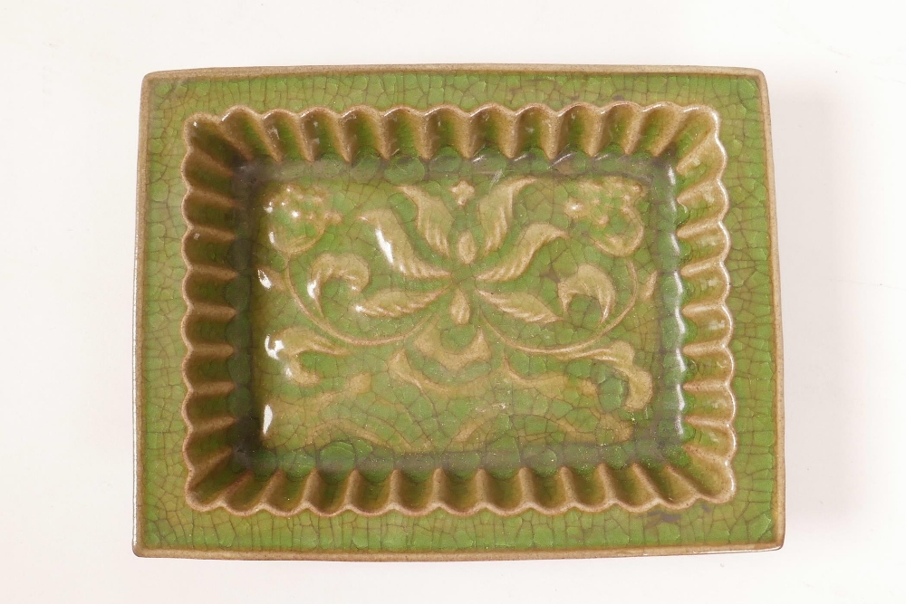 Lot 8 - A Chinese green glazed pottery trinket dish with a ribbed interior and raised lotus flower