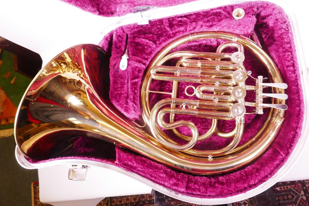 Lot 12 - A brass French horn in fitted case