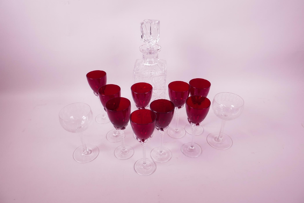 "Lot 2 - A set of nine ruby wine glasses with clear twist stems, 5¾"" high, a pair of etched long stem wine"