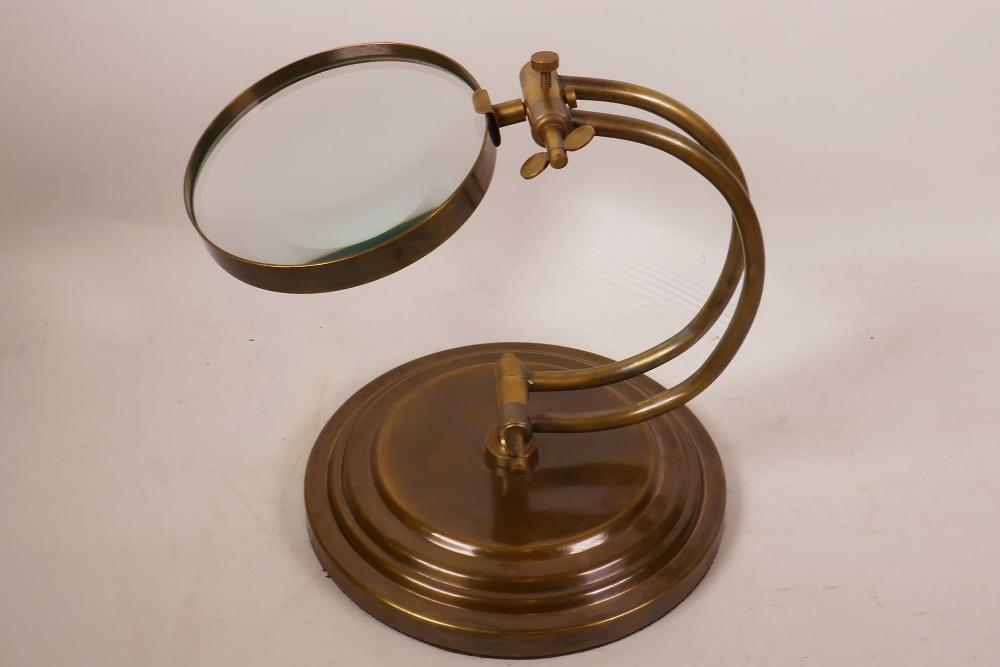 "Lot 14 - A brass framed desktop magnifying glass, lens 5"" diameter"