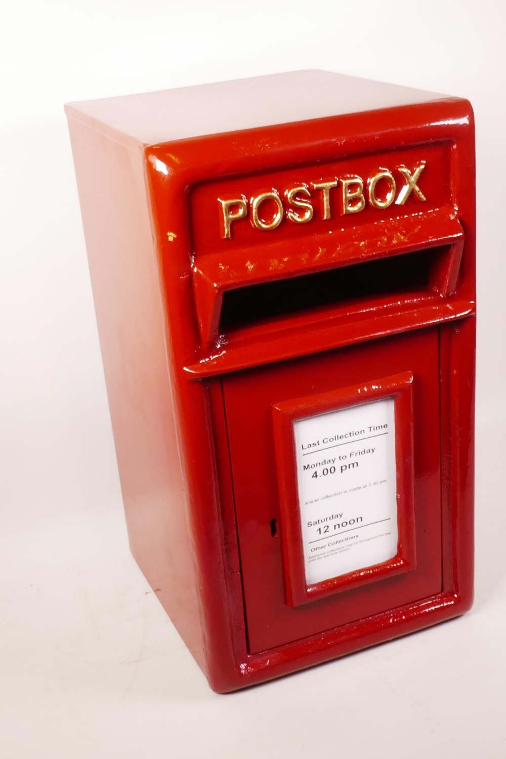 "Lot 4 - A metal postbox with cast iron front panel and door, 17½"" high, 9½"" wide, 10½"" wide"