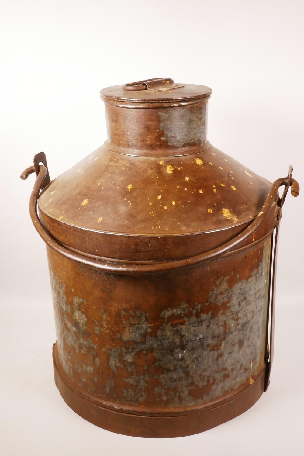"Lot 19 - A metal milk churn with iron swing handle, 20"" high, 18"" diameter"