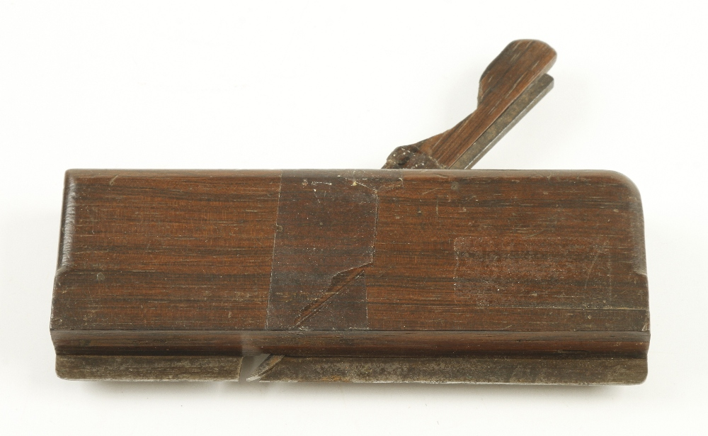 "Lot 56 - A small rosewood grooving plane 5 3/4"" long G+"