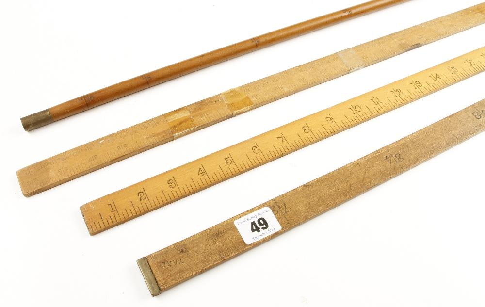 "Lot 49 - A 36"" dip rule by RABONE No 1035 and three yard sticks G"