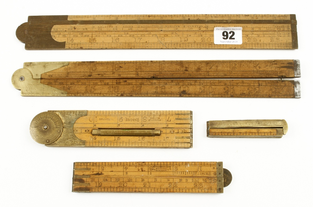"""Lot 92 - Two 24"""" boxwood slide rules and three four folds G"""